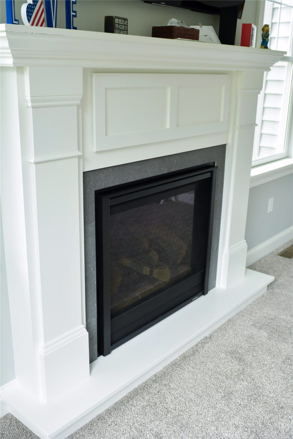 Fireplace and Mantel over Carpet with Molding