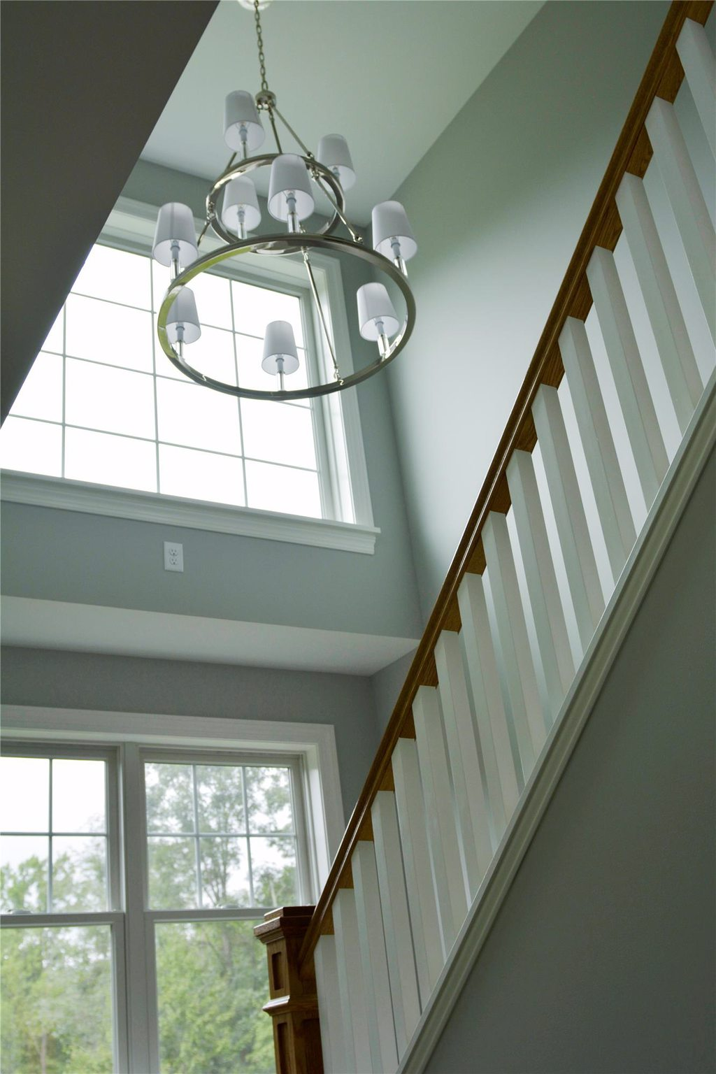 Vaulted Ceiling Staircase with Modern Chandeler